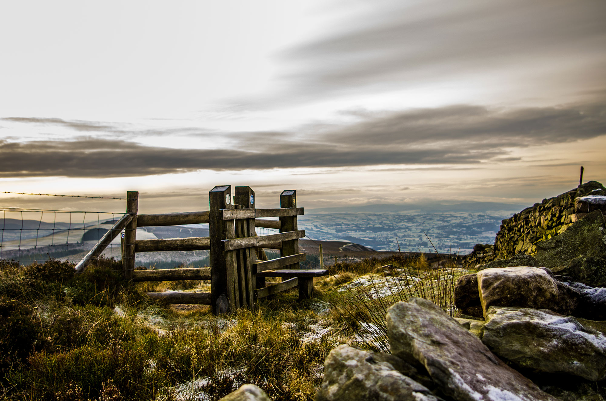 *Oak stile on Moel Famau with Vale of Clwyd in distance