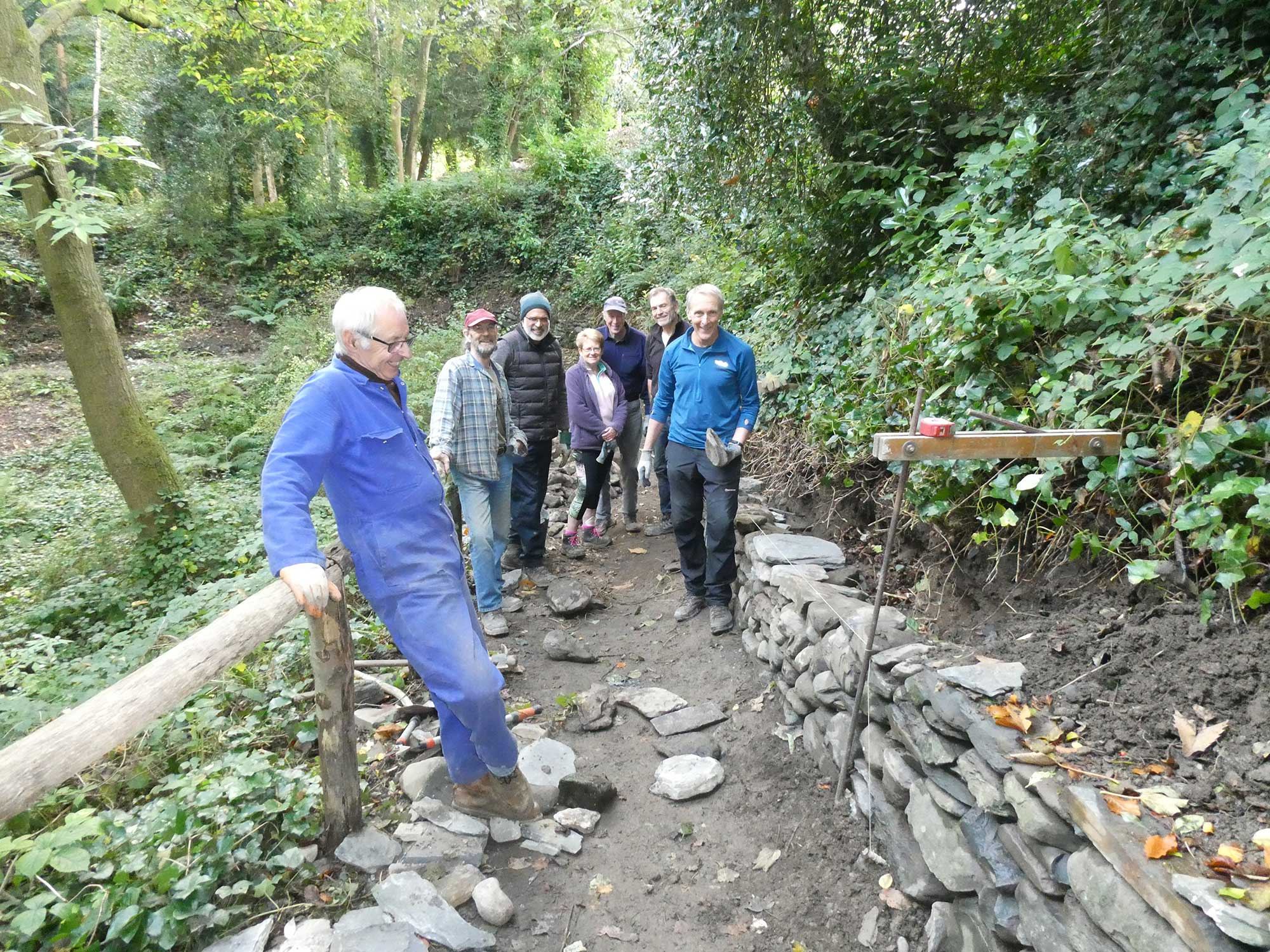Volunteers restoring a dry stone wall