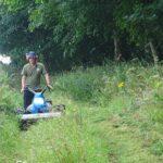 *AONB Ranger-mowing a wildflower meadow